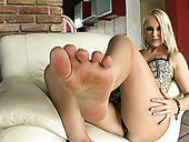 Jasmin Shows Her Feet And Rubs Them