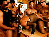 Filthy Brunette MILF Gives Blowjob To Bunch Of Hard Cocks In Gangbang