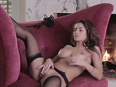 Sexy Hot Girlie Danni Gee Masturbates With A Dildo Near The Fireplace