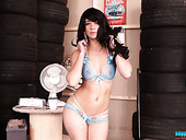 Leggy Brunette Tracy Rose Shows Striptease In The Tire Truck Center