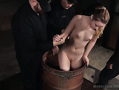 Mistress And Black Assistant Punish Mouth Of Jessica Kay Sitting In The Wooden Barrel