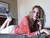 This Blonde Loves Posing Half Naked For The Camera And She Loves Smoking