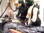 Two Busty Laboratory Assistants Suck Dick Of One Horny Guy In Latex Costume