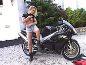 Sexy Biker Girl Mia Stone Masturbates Outdoors Over Her Black Bike