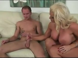 Blonde Big Boobs Goes Naked And Gives Handjob On Couch